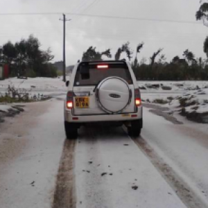 An image taken by a Kenyan and posted on facebook shows hailstorm covered road on Monday.