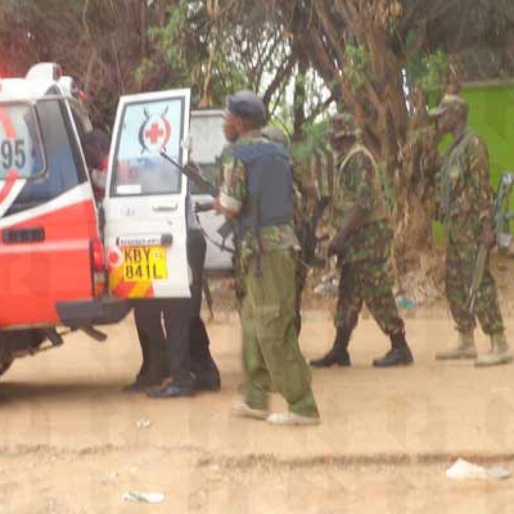 Policemen help one of the people injured in an attack at Garissa University College into an ambulance on April 2, 2015. PHOTO   ABDIMALIK HAJIR   NATION MEDIA GROUP