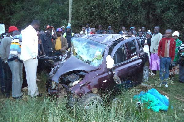 Residents of Manguo village in Limuru constituency at the scene of a road crash on Sunday