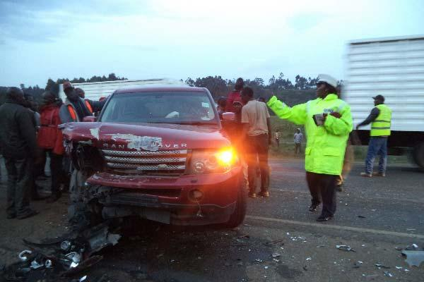 Residents of Manguo village in Limuru constituency at the scene of a road crash.