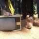 Activists Dump Outdated TVs, chicken outside Government Offices In Protest Against Kenya Switch-off