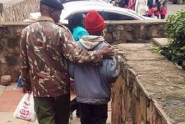 PHOTOS: Police Officer Moves Kenyans After Doing This to Street Boy